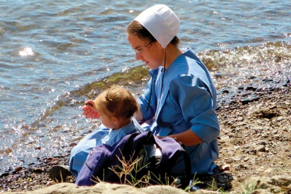 Amish-girl-and-child-at-river.jpg